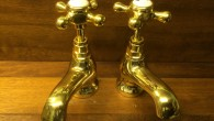 ****  FOR SALE  **** These solid brass basin taps have almost a French theme to their shape and design. With their upswept spouts and skirted base. Fully refurbished...